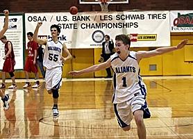 by: MILES VANCE, UPSET SPECIAL — Valley Catholic's Michael Lyon (right) and Andy Haugen celebrate at the end of their team's 54-50 win over Santiam Christian at the 3A state tourney.