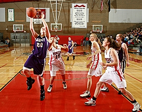 by: CRAIG MITCHELLDYER, APOLLO RISING — Sunset freshman Samantha Potter goes in to score two of her team-high 14 points during the Apollos' Tuesday night loss at Oregon City.