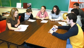 by: Garth Guibord, From left, Sandy High School seniors Kate McKague, Ashley Day, Megan Murphy, Laura