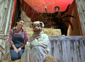 "by: Jonathan House, HAY-NGING AROUND — Tigard High School drama students Kelsey Reddicks, left, Austin McKee, center, and Julia Golden as the spider Charlotte get into character for the school's production of ""Charlotte's Web."""