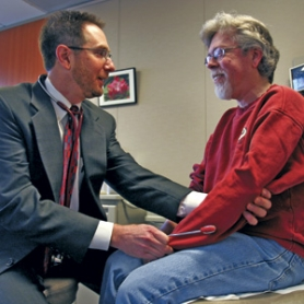 "by: JIM CLARK, Dr. Charles Kilo of GreenField Health examines patient Don Hoffman. GreenField's ""concierge"" practice offers same-day office visits and e-mail and phone contact with the doctors for a $300 annual retainer fee."