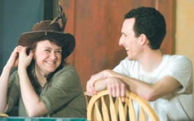 "by: John Klicker, Kelly Lazenby shares a laugh with her new husband and co-star Justin Lazenby, after a rehearsal of ""The Rainmaker"" on Tuesday, Feb. 27, at the Boring-Damascus Grange hall. Kelly and Justin were friends for several years before falling in love on the set of ""Princess and the Pea,"" the children's play put on by Nutz-n-Boltz Theater Company in 2006."