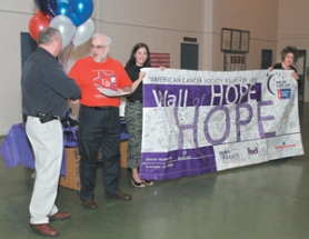 by: Shanda Tice, Eric Jones, middle, shakes hands with Wall of Hope sponsor Tom Lalonde, left, general manager of Glacier Northwest, while American Cancer Society staff partners Victoria Ten Broeck and Holly Ball hold up Gresham's Wall of Hope.