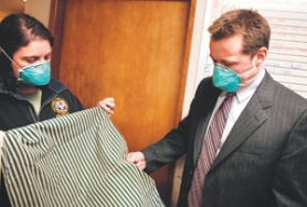 by: Matthew Ginn, Gresham Mayor Shane Bemis, right, looks at Captain Cindy Thompson-Baird's pillowcase, which became saturated with mold over just two weeks in January while she was away. She had washed the pillowcase before leaving for a training assignment.