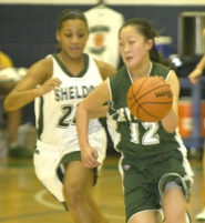 by: David Ball, Reynolds sophomore Renee Tzeo rushes upcourt after stealing the ball away from Sheldon's Mohona Doe during the Raiders' 60-53 playoff loss Friday night.