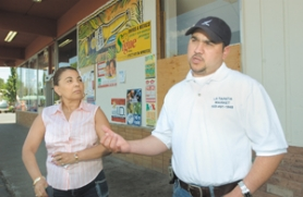 by: File photo, Store owners Mila Villavicencio and Mauricio Alvarez are still trying to get some help with moving costs.
