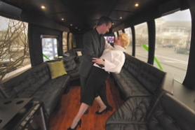 "by: Vern Uyetake, West Linn couple Graham and Jennifer Berry cut a rug inside their custom luxury bus, which can be rented out by the hour and taken for a spin. Graham travels along to host the ""parties,"" and the couple recently added professional drivers to their company."