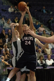 by: Vern Uyetake, Lake Oswego's Ali Lomax scores from close range to give Lake Oswego the lead for good at 31-29 with 2:55 left in the fourth quarter of Wednesday's state quarterfinal game against Sheldon. Despite a slow start, Lake Oswego rallied for a 40-32 victory, moving the Lakers into Friday's semifinal game.