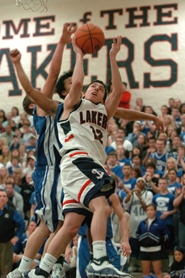 by: Vern Uyetake, The Lakers' Kevin Love battles South Medford's Kyle Singler for a rebound.
