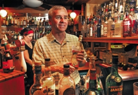 by: JIM CLARK, Séamus Blaney of the Leaky Roof says customers who ask for scotch might get a bit of an education, too. He stocks scotch but carries more than 25 different bottles of Irish whiskey.