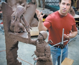 by: Kristina Wright, Using a one-quarter scale model, bronze artist Rip Caswell explains the symbolism of the sculpture he is creating in the memory of Army Pfc. Thomas Tucker, a Madras resident who was killed in Iraq.