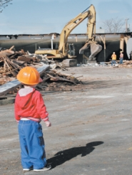 by: Shanda Tice, Jonas Butler, almost 2, keeps a close watch Thursday, March 15, on the progress of the deconstruction of the Rockwood Fred Meyer on Southeast Stark Street where more than 95 percent of materials will reused or recycled.