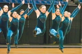 "by: John Klicker, Reynolds High School Dance/Drill team members perform their routine ""Forgiven"" on Thursday, March 15, in the Class 6A Small Division of the state championships at Memorial Coliseum in Portland."