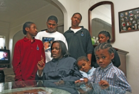 by: L.E. BASKOW, Perlia Bell (middle) has been raising her grandchildren since Asia was shot to death in 2002. Clockwise from left are: Grandson Tre'viontae Savage, 12; son Hollis McClure, 25; grandson Kawontaye Bell, 14; Asianique Savage, 9; grandson Tyz'juan James, 5; and granddaughter Ajialia McClure, 3.