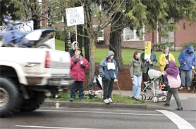 by: Chase Allgood, Critics of the war in Iraq gathered Monday along Pacific Avenue in Forest Grove a day after weekend protests were held across the country to note the four-year mark in the conflict.