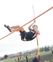 by: Chase Allgood, Banks sophomore Steven Murray clears the bar last Thursday during the pole vault event at a home track and field meet.
