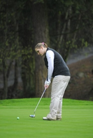by: Vern Uyetake, Ellie Enderle focuses on a putt during last Monday's league meet at Oswego Lake Country Club.
