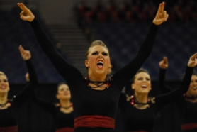 by: Vern Uyetake, Kirsta Allen gets pumped up during the dance team's performance in front of a huge audience.