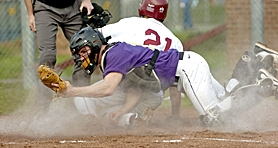 by: JOHN LARIVIERE, SAFE AT HOME — Tualatin's Levi Levasa slides safely home as Sunset catcher Kerry Degman lets the ball slip into the cloud of dust during the Apollos' 8-2 win over the Timberwolves at Sunset High School last week.