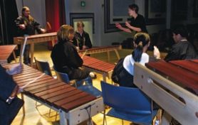 by: Tom Baker, Project administrator Rebekah Phillips conducts the Binnsmead Marimba Band during a rehearsal last year at the middle school. With more students likely to participate as Binnsmead changes to K-8, the teacher who oversees the group worries that resources will be stretched too far, a criticism cropping up as many schools prepare for reconfiguration.