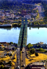 by: L.E. Baskow, The Interstate 5 bridge between Portland and Vancouver, Wash., exceeds its capacity at least four hours a day, according to a light-rail advocate who says a commuter-rail bridge could alleviate the problem.