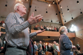 "by: Shanda Tice, Bob Stewart, 82, traveled from Roseburg to join the dedication service of the new sanctuary at the Lynchwood Church of God on Southeast 174th Avenue held Sunday, March 18. A former pastor of the church from 1960 to '70, Stewart helped build the original church sanctuary and gymnasium. The congregation is singing ""Great is Thy Faithfulness."""