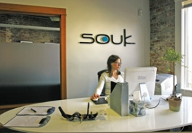 by: JIM CLARK, Souk founder Julie Duryea sits in the lobby of her flexible work-space facility in Old Town, where members pay for the use of office amenities, a desk and meeting rooms.