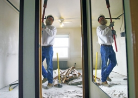 by: JIM CLARK, Carpenter Gene Roberts tears out a closet at Bradley-Angle House, a women's emergency center getting a green remodel with help from the Zero Waste Alliance.
