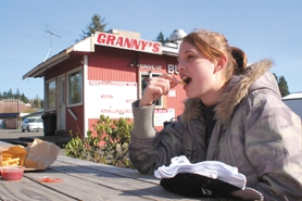 by: Barbara Adams, Tiffany Fondren, 17, enjoys fries and a soda at Granny's Drive-Thru Restaurant after school.