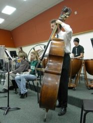 by: NoleneTriska, Oregon Symphony bassist Jason Schooler plays with the Estacada High School symphonic band class in March as part of the Community Music Partnership.