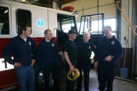 by: marcus hathcock, Glenn Yeager, center, jokes around with his firefighting buddies at the Sandy Fire Station.
