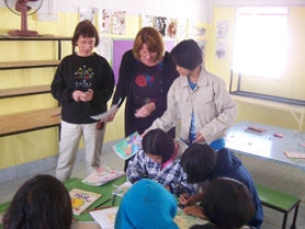 "by: Submitted photo, Sharon Starr, left, and Lynn Wintermute get the kids started during art class at the Children of the Golden Triangle Center. Wintermute said she was ""absolutely flabbergasted"" by the children's artwork."