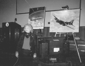 by: Submitted photo, Lake Oswego resident, pilot and artist Jerry Ghiglieri gave a presentation of her aviation art and experiences on March 23 to celebrate Women's History Day at Evergreen Aviation Museum in McMinnville.