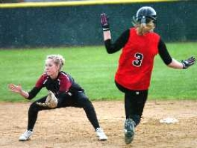 by: Dan Brood, READY FOR ACTION — Tualatin shortstop Jordan Skinner (left) awaits the throw as Clackamas' Maddie Taylor heads toward second base in Friday's game.