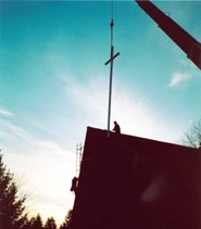by: Submitted photo, A new cross was installed on the Sherwood United Methodist Church in March. The church had been without a cross since the old wood cross rotted out.