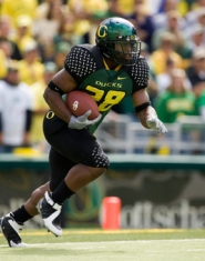 by: ©2006 JOHN GIUSTINA, Jonathan Stewart came close to 1,000 yards rushing last season for the Ducks.