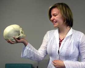 "by: Barbara Sherman, THE WINTER OF OUR DISCONTENT — THS senior Katey Merrick can't use props when she performs her monologue from ""Richard III"" at the National Shakespeare Competition, but she got in the spirit of the play last week with a skull borrowed from the THS lab."