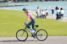 by: Matthew Ginn, Christina Brown, 12, of Gresham, enjoyed Thursday afternoon's sunshine by riding her bike through Blue Lake Regional Park.