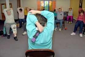 by: Aubrie Aurand, Joy Ward leads a stretch class at Powell Valley Covenant Church in Gresham on Wednesday evening, March 28. Participants use a variety of exercises to stay limber.