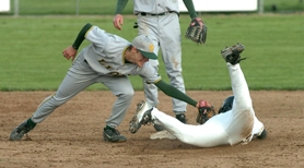 by: Vern Uyetake, West Linn's Ryan Barnes places a tag on a Rex Putnam runner attemping to steal second. The runner was gunned down on a throw by Lions' catcher Mitch Bailey. The Lions lost the game 3-0 and are now 1-1 in the Three Rivers League standings.