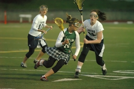 by: Vern Uyetake, West Linn's Erika Busch attempts to run past Lake Oswego defender, Lauren Groth. Busch scored the Lions' first goal of the game last Tuesday, but the Lakers were able to hold on for the 6-5 victory. The loss was West Linn's first of the season and they will take on Wilson at home next Tuesday.