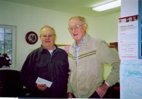 by: Contributed photo, Joe Guttridge presents a check from the Springwater Grange to Harold Wick for the Estacada Area Food Bank.