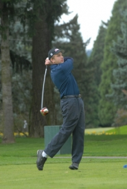 by: Vern Uyetake, Lake Oswego's Kevin Gay eyes a tee shot during Monday's league golf tournament at Waverley Country Club. Gay claimed medalist honors in the event by shooting a 2-over-par 74. That helped Lake Oswego to first place in the team competition. The Lakers shot 318 as a team while Lakeridge took second place with a 332 score.