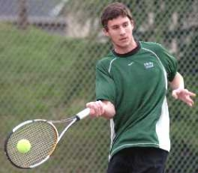 by: DAN BROOD, INTO THE SWING OF THINGS — Tigard's Anthony Breitenbach gets his racquet on the ball in the Tigers' match at Tualatin on Tuesday.