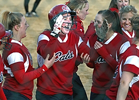 by: JAIME VALDEZ, WINNERS — Kayla Turner (center) celebrates her first pitch lead-off home run in the  top of the seventh inning of her team's 6-3 win at Tualatin.