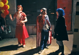 by: DENISE FARWELL, Giovani Knox (left) juggles while a patriot of sorts joins other costumed partygoers outside Rotture for an April Fools' Eve international carnival. A statuesque fortuneteller, tickling mermaids and bands from Mirumir to Trashcan Joe awaited inside.