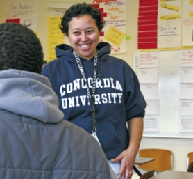 by: JIM CLARK, Concordia student Becky Miller volunteers as a tutor at Rosemary Anderson High School as part of a new outreach program at the Northeast Portland college.