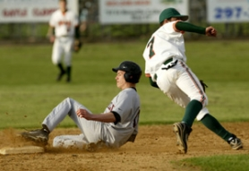 by: JIM CLARK, Franklin's Scott Burris slides into second base past Wilson's Brent Graham. Wilson won 2-0 Wednesday at Franklin after a pitching duel between Burris and the Trojans' Joey Mahalic.