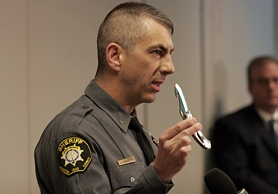 by: Jonathan House, SHERIFF'S REVIEW - Washington County Chief Deputy Pat Garrett holds a knife similar to the one Lukus Glenn had when county deputies confronted him in a standoff at his parent's home Sept. 16.  The sheriff's administrative review determined that no deputies were at fault for their actions.