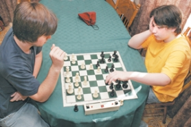 by: Shanda Tice, Competition between Steven Breckenridge (right), 15, and his brother, David, 17, is intense and speed is the name of the game as they play chess around their dining room table Thursday, April 5.